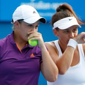MELBOURNE, AUSTRALIA - JANUARY 16:  Casey Dellacqua of Australia and Ashleigh Barty of Australia talk tactics in their first round doubles match against Alexandra Panova of Russia and Karolina Pliskova of the Czech Republic  during day four of the 2014 Australian Open at Melbourne Park on January 16, 2014 in Melbourne, Australia.  (Photo by Scott Barbour/Getty Images)