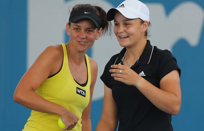 BRISBANE, AUSTRALIA - DECEMBER 31:  Casey Dellacqua and Ashleigh Barty of Australia celebrate after winning a point in their doubles match against Varvara Lepchenko of the USA and Raluca Olaru of Romania during day three of the 2014 Brisbane International at Queensland Tennis Centre on December 31, 2013 in Brisbane, Australia.  (Photo by Chris Hyde/Getty Images)