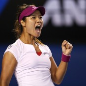 MELBOURNE, AUSTRALIA - JANUARY 25: Na Li of China celebrates winning the first set in her women's final match against Dominika Cibulkova of Slovakia during day 13 of the 2014 Australian Open at Melbourne Park on January 25, 2014 in Melbourne, Australia.  (Photo by Clive Brunskill/Getty Images)