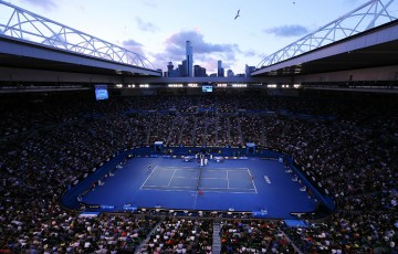 MELBOURNE, AUSTRALIA - JANUARY 25: A general view of Rod Laver Arena as Dominika Cibulkova of Slovakia serves in her women's final match against Na Li of China during day 13 of the 2014 Australian Open at Melbourne Park on January 25, 2014 in Melbourne, Australia.  (Photo by Quinn Rooney/Getty Images)
