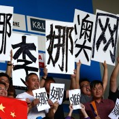 MELBOURNE, AUSTRALIA - JANUARY 25:  Fans of Na Li of China watch her in her women's final match against Dominika Cibulkova of Slovakia during day 13 of the 2014 Australian Open at Melbourne Park on January 25, 2014 in Melbourne, Australia.  (Photo by Matt King/Getty Images)
