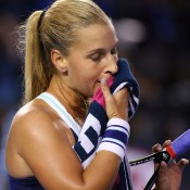 MELBOURNE, AUSTRALIA - JANUARY 25:  Dominika Cibulkova of Slovakia wipes her face in her women's final match against Na Li of China during day 13 of the 2014 Australian Open at Melbourne Park on January 25, 2014 in Melbourne, Australia.  (Photo by Mark Kolbe/Getty Images)