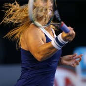MELBOURNE, AUSTRALIA - JANUARY 25:  Dominika Cibulkova of Slovakia plays a forehand in her women's final match against Na Li of China during day 13 of the 2014 Australian Open at Melbourne Park on January 25, 2014 in Melbourne, Australia.  (Photo by Mark Kolbe/Getty Images)