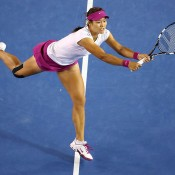 MELBOURNE, AUSTRALIA - JANUARY 25:  Na Li of China plays a backhand in her women's final match against Dominika Cibulkova of Slovakia during day 13 of the 2014 Australian Open at Melbourne Park on January 25, 2014 in Melbourne, Australia.  (Photo by Quinn Rooney/Getty Images)