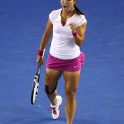 MELBOURNE, AUSTRALIA - JANUARY 25:  Na Li of China celebrates winning the first set in her women's final match against Dominika Cibulkova of Slovakia during day 13 of the 2014 Australian Open at Melbourne Park on January 25, 2014 in Melbourne, Australia.  (Photo by Quinn Rooney/Getty Images)