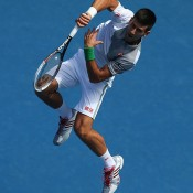 MELBOURNE, AUSTRALIA - JANUARY 19:  Novak Djokovic of Serbia plays a forehand in his fourth round match against Fabio Fognini of Italy during day seven of the 2014 Australian Open at Melbourne Park on January 19, 2014 in Melbourne, Australia.  (Photo by Chris Hyde/Getty Images)