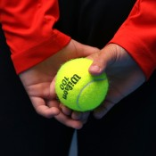 MELBOURNE, AUSTRALIA - JANUARY 19:  A ballboy holds a tennis ball during day seven of the 2014 Australian Open at Melbourne Park on January 19, 2014 in Melbourne, Australia.  (Photo by Michael Dodge/Getty Images)