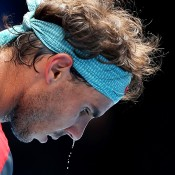 MELBOURNE, AUSTRALIA - JANUARY 20:  Details of sweat dripping off Rafael Nadal of Spain as he prepares to serve in his fourth round match against Kei Nishikori of Japan during day eight of the 2014 Australian Open at Melbourne Park on January 20, 2014 in Melbourne, Australia.  (Photo by Matt King/Getty Images)