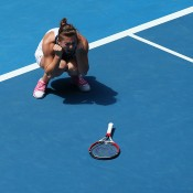 MELBOURNE, AUSTRALIA - JANUARY 20:  Simona Halep of Romania celebrates winning in her fourth round match against Jelena Jankovic of Serbia during day eight of the 2014 Australian Open at Melbourne Park on January 20, 2014 in Melbourne, Australia.  (Photo by Chris Hyde/Getty Images)