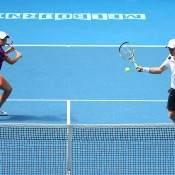 MELBOURNE, AUSTRALIA - JANUARY 20:  Ashleigh Barty of Australia and John Peers of Australia in action in their second round mixed doubles match against Katarina Srebotnik of Slovenia and Rohan Bopanna of India during day eight of the 2014 Australian Open at Melbourne Park on January 20, 2014 in Melbourne, Australia.  (Photo by Quinn Rooney/Getty Images)