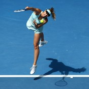 MELBOURNE, AUSTRALIA - JANUARY 20:  Maria Sharapova of Russia serves in her fourth round match against Dominika Cibulkova of Slovakia during day eight of the 2014 Australian Open at Melbourne Park on January 20, 2014 in Melbourne, Australia.  (Photo by Matt King/Getty Images)