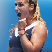 MELBOURNE, AUSTRALIA - JANUARY 20:  Dominika Cibulkova of Slovakia celebrates a point in her fourth round match against Maria Sharapova of Russia during day eight of the 2014 Australian Open at Melbourne Park on January 20, 2014 in Melbourne, Australia.  (Photo by Clive Brunskill/Getty Images)