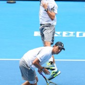 MELBOURNE, AUSTRALIA - JANUARY 20:  Mike Bryan of the United States and Bob Bryan of the United States in action in their third round doubles match against Eric Butorac of the United States and Raven Klaasen of South Africa during day eight of the 2014 Australian Open at Melbourne Park on January 20, 2014 in Melbourne, Australia.  (Photo by Chris Hyde/Getty Images)