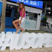 MELBOURNE, AUSTRALIA - JANUARY 21:  Australian professional surfer, Sally Fitzgibbons posing on the Ausopen hashtag during day 9 of the 2014 Australian Open at Melbourne Park on January 21, 2014 in Melbourne, Australia.  (Photo by Vince Caligiuri/Getty Images)