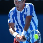 MELBOURNE, AUSTRALIA - JANUARY 21:  Tomas Berdych of the Czech Republic plays a backhand in his quarterfinal match against David Ferrer of Spain during day nine of the 2014 Australian Open at Melbourne Park on January 21, 2014 in Melbourne, Australia.  (Photo by Quinn Rooney/Getty Images)