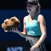 MELBOURNE, AUSTRALIA - JANUARY 21:  Eugenie Bouchard of Canada holds a toy wombat thrown to her from the crowd after winning her quarterfinal match against Ana Ivanovic of Serbia during day nine of the 2014 Australian Open at Melbourne Park on January 21, 2014 in Melbourne, Australia.  (Photo by Michael Dodge/Getty Images)