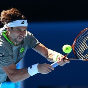MELBOURNE, AUSTRALIA - JANUARY 21:  David Ferrer of Spain plays a backhand in his quarterfinal match against Tomas Berdych of the Czech Republic during day nine of the 2014 Australian Open at Melbourne Park on January 21, 2014 in Melbourne, Australia.  (Photo by Quinn Rooney/Getty Images)