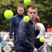 MELBOURNE, AUSTRALIA - JANUARY 21:  Musician Liam Gallagher faces the hotshots ball kids during day 9 of the 2014 Australian Open at Melbourne Park on January 21, 2014 in Melbourne, Australia.  (Photo by Vince Caligiuri/Getty Images)