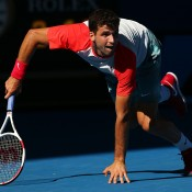 MELBOURNE, AUSTRALIA - JANUARY 22:  Grigor Dimitrov of Bulgaria gets back on his feet after a fall in his quarterfinal match against Rafael Nadal of Spain during day 10 of the 2014 Australian Open at Melbourne Park on January 22, 2014 in Melbourne, Australia.  (Photo by Quinn Rooney/Getty Images)