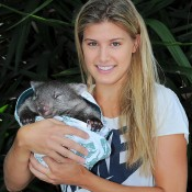 MELBOURNE, AUSTRALIA - JANUARY 22:  Eugenie Bouchard of Canada holding a Wombat at the player Cafe during day 10 of the 2014 Australian Open at Melbourne Park on January 22, 2014 in Melbourne, Australia.  (Photo by Vince Caligiuri/Getty Images)