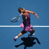MELBOURNE, AUSTRALIA - JANUARY 22:  Victoria Azarenka of Belarus plays a forehand in her quarterfinal match against Agnieszka Radwanska of Poland during day 10 of the 2014 Australian Open at Melbourne Park on January 22, 2014 in Melbourne, Australia.  (Photo by Michael Dodge/Getty Images)
