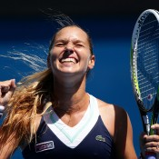 MELBOURNE, AUSTRALIA - JANUARY 22:  Dominika Cibulkova of Slovakia celebrates winning her quarterfinal match against Simona Halep of Romania during day 10 of the 2014 Australian Open at Melbourne Park on January 22, 2014 in Melbourne, Australia.  (Photo by Matt King/Getty Images)