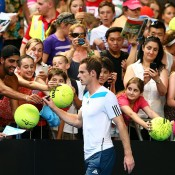 MELBOURNE, AUSTRALIA - JANUARY 14:  Andy Murray of Great Britain signs autographs after winning his first round match against Go Soeda of Japan during day two of the 2014 Australian Open at Melbourne Park on January 14, 2014 in Melbourne, Australia.  (Photo by Cameron Spencer/Getty Images)