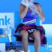 Jelena Jankovic of Serbia cools off with ice during a break in her first round match against Misaki Doi of Japan during day two of the 2014 Australian Open at Melbourne Park on January 14, 2014 in Melbourne, Australia.  (Photo by Michael Dodge/Getty Images)