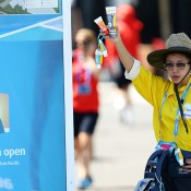 A vendor holds sunscreen as Melbourne heads towards 43 degrees celsius (109 degrees fahrenheit) during day two of the 2014 Australian Open at Melbourne Park on January 14, 2014 in Melbourne, Australia.  (Photo by Matt King/Getty Images)