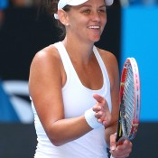 MELBOURNE, AUSTRALIA - JANUARY 15:  Casey Dellacqua of Australia celebrates winning her second round match against Kirsten Flipkens of Belgium during day three of the 2014 Australian Open at Melbourne Park on January 15, 2014 in Melbourne, Australia.  (Photo by Scott Barbour/Getty Images)