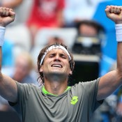 MELBOURNE, AUSTRALIA - JANUARY 15:  David Ferrer of Spain celebrates winning his second round match against Adrian Mannarino of France during day three of the 2014 Australian Open at Melbourne Park on January 15, 2014 in Melbourne, Australia.  (Photo by Scott Barbour/Getty Images)