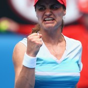 MELBOURNE, AUSTRALIA - JANUARY 15:  Monica Niculescu of Romania celebrates winning her second round match against Sabine Lisicki of Germany during day three of the 2014 Australian Open at Melbourne Park on January 15, 2014 in Melbourne, Australia.  (Photo by Ryan Pierse/Getty Images)