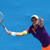 MELBOURNE, AUSTRALIA - JANUARY 17:  Ashleigh Barty of Australia plays a forehand in her first round mixed doubles match with John Peers of Australia against Olivia Rogowska of Australia John-Patrick Smith of Australia during day five of the 2014 Australian Open at Melbourne Park on January 17, 2014 in Melbourne, Australia.  (Photo by Robert Prezioso/Getty Images)
