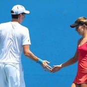 MELBOURNE, AUSTRALIA - JANUARY 17:  Olivia Rogowska of Australia and John-Patrick Smith of Australia talk tactics in their first round mixed doubles match against Ashleigh Barty of Australia and John Peers of Australia during day five of the 2014 Australian Open at Melbourne Park on January 17, 2014 in Melbourne, Australia.  (Photo by Robert Prezioso/Getty Images)