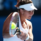 MELBOURNE, AUSTRALIA - JANUARY 17:  Casey Dellacqua of Australia plays a backhand in her third round match against Jie Zheng of China during day five of the 2014 Australian Open at Melbourne Park on January 17, 2014 in Melbourne, Australia.  (Photo by Matt King/Getty Images)