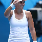 MELBOURNE, AUSTRALIA - JANUARY 17:  Casey Dellacqua of Australia celebrates winning her third round match against Jie Zheng of China during day five of the 2014 Australian Open at Melbourne Park on January 17, 2014 in Melbourne, Australia.  (Photo by Matt King/Getty Images)