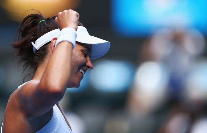 MELBOURNE, AUSTRALIA - JANUARY 17:  Casey Dellacqua of Australia celebrates winning her third round match against Jie Zheng of China during day five of the 2014 Australian Open at Melbourne Park on January 17, 2014 in Melbourne, Australia.  (Photo by Ryan Pierse/Getty Images)