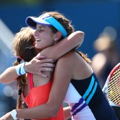 MELBOURNE, AUSTRALIA - JANUARY 17: Julia Goerges of Germany and Barbora Zahlavova Strycova of the Czech Republic celebrate in their first round doubles match against Naiktha Bains of Australia and Olivia Tjandramulia of Australia during day five of the 2014 Australian Open at Melbourne Park on January 17, 2014 in Melbourne, Australia.  (Photo by Renee McKay/Getty Images)