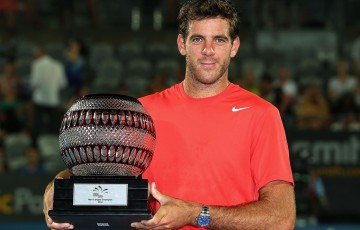 SYDNEY, AUSTRALIA - JANUARY 11:  Juan Martin Del Potro of Argentina poses with the trophy after winning the mens singles final against Bernard Tomic of Australia during day seven of the Sydney International at Sydney Olympic Park Tennis Centre on January 11, 2014 in Sydney, Australia.  (Photo by Brendon Thorne/Getty Images)
