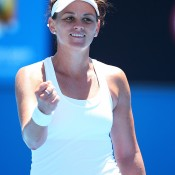 Dellacqua of Australia celebrates winning her first round match against Vera Zvonareva of Russia  during day one of the 2014 Australian Open at Melbourne Park on January 13, 2014 in Melbourne, Australia.  (Photo by Chris Hyde/Getty Images)