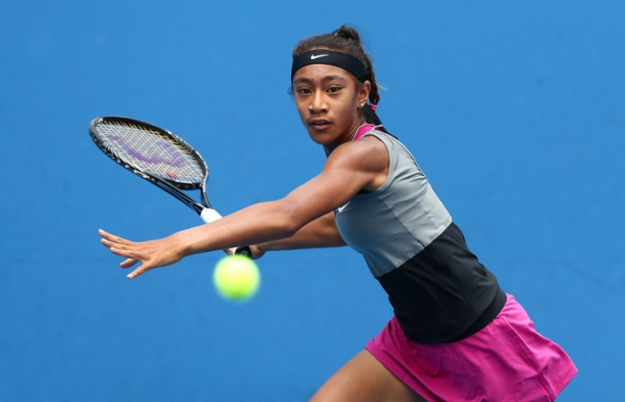 MELBOURNE, AUSTRALIA - JANUARY 18:  Destanee Aiava of Australia plays a forehand in her first round junior girls' match against Verena Hofer of Italy during the 2014 Australian Open Junior Championships at Melbourne Park on January 18, 2014 in Melbourne, Australia.  (Photo by Matt King/Getty Images)
