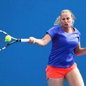 Jelena Dokic of Australia plays a forehand in her first round women's doubles match with Storm Sanders of Australia against Magdalena Rybarikova of Slovakia and Stefanie Voegele of Switzerland during day three of the 2014 Australian Open at Melbourne Park on January 15, 2014 in Melbourne, Australia.  (Photo by Renee McKay/Getty Images)