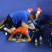 MELBOURNE, AUSTRALIA - JANUARY 26:  Rafael Nadal of Spain receives a back massage in his men's final match against Stanislas Wawrinka of Switzerland during day 14 of the 2014 Australian Open at Melbourne Park on January 26, 2014 in Melbourne, Australia.  (Photo by Michael Dodge/Getty Images)
