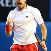 MELBOURNE, AUSTRALIA - JANUARY 26:  Stanislas Wawrinka of Switzerland celebrates winning the first set in his men's final match against Rafael Nadal of Spain during day 14 of the 2014 Australian Open at Melbourne Park on January 26, 2014 in Melbourne, Australia.  (Photo by Quinn Rooney/Getty Images)