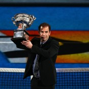 MELBOURNE, AUSTRALIA - JANUARY 26:  Former tennis player Pete Sampras holds the Norman Brookes Challenge Cup ahead of the men's final match between Rafael Nadal of Spain and Stanislas Wawrinka of Switzerland during day 14 of the 2014 Australian Open at Melbourne Park on January 26, 2014 in Melbourne, Australia.  (Photo by Graham Denholm/Getty Images)