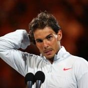 MELBOURNE, AUSTRALIA - JANUARY 26:  Rafael Nadal of Spain wipes his face during his speech after losing his men's final match against Stanislas Wawrinka of Switzerland during day 14 of the 2014 Australian Open at Melbourne Park on January 26, 2014 in Melbourne, Australia.  (Photo by Mark Kolbe/Getty Images)