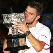 MELBOURNE, AUSTRALIA - JANUARY 26:  Stanislas Wawrinka of Switzerland kisses the Norman Brookes Challenge Cup after winning his men's final match against Rafael Nadal of Spain during day 14 of the 2014 Australian Open at Melbourne Park on January 26, 2014 in Melbourne, Australia.  (Photo by Mark Kolbe/Getty Images)