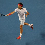 MELBOURNE, AUSTRALIA - JANUARY 16:  Roger Federer of Switzerland plays a forehand in his second round match against Blaz Kavcic of Slovenia during day four of the 2014 Australian Open at Melbourne Park on January 16, 2014 in Melbourne, Australia.  (Photo by Michael Dodge/Getty Images)