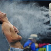 MELBOURNE, AUSTRALIA - JANUARY 16:  Jerzy Janowicz of Poland in front of fan coolers at Grand Slam Oval during day 4 of the 2014 Australian Open at Melbourne Park on January 16, 2014 in Melbourne, Australia.  (Photo by Vince Caligiuri/Getty Images)