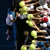 MELBOURNE, AUSTRALIA - JANUARY 16: Jo-Wilfried Tsonga of France signs autographs after winning in his second round match against Thomaz Bellucci of Brazil during day four of the 2014 Australian Open at Melbourne Park on January 16, 2014 in Melbourne, Australia.  (Photo by Michael Dodge/Getty Images)